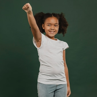 Cute girl child holding a hand in the air