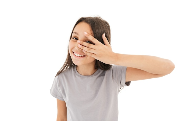 Cute girl covering eyes with hands