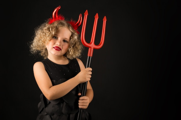 Cute girl in devil costume