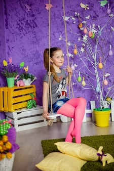 Cute girl in easter decorated room