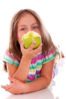 Cute girl eating an apple