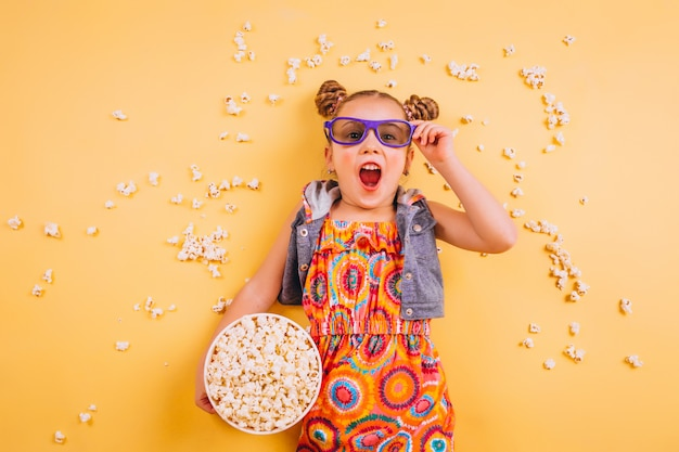 Cute girl eating popcorn