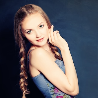 Cute girl fashion model with braids hairstyle