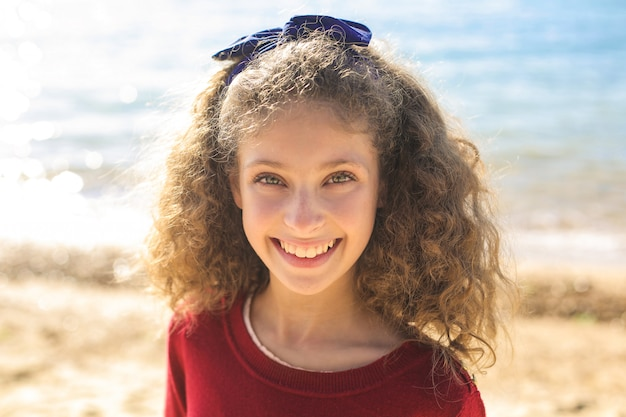 Cute girl having good time at the beach