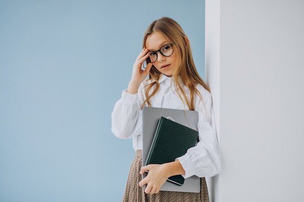 Cute girl holding book and laptop in the office