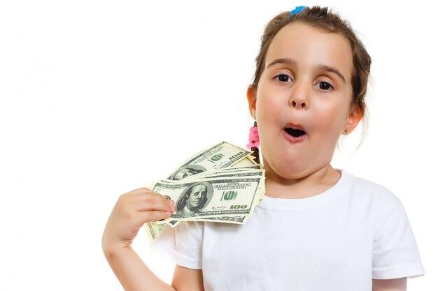 Cute girl holding money