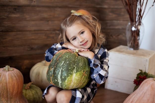 Cute girl holding a pumpkin