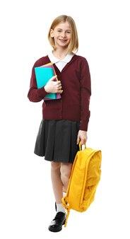 흰색 바탕에 책가방과 책을 들고 교복을 입은 귀여운 소녀