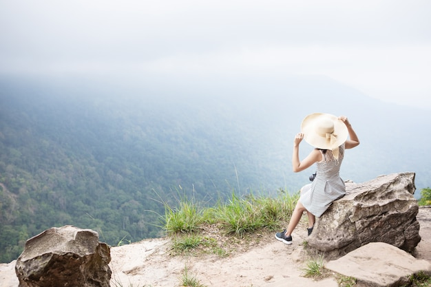 Cute girl is traveling on high mountain. khao yai national park, thailand.