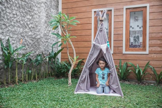 Cute girl playing in the backyard