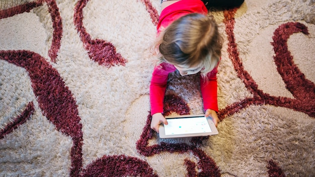 Cute girl playing tablet game