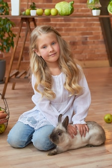 Cute girl playing with rabbit