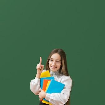 Cute girl pointing up medium shot