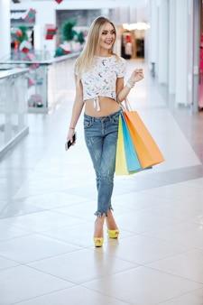 Cute girl posing at shopping mall