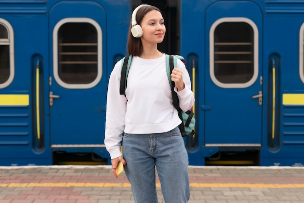 Cute girl at the railway station front view