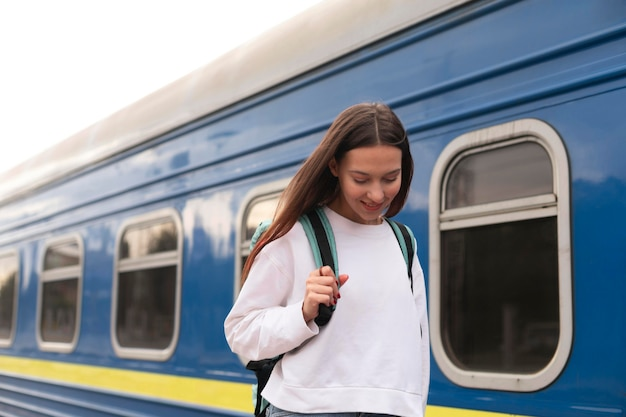 Cute girl at the railway station looking down