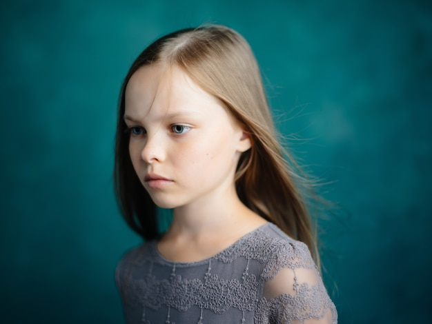 Cute girl sad facial expression close up studio. high quality photo