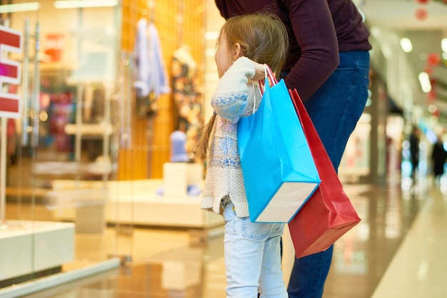 Cute girl shopping with mom