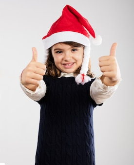 Cute girl showing thumbs up