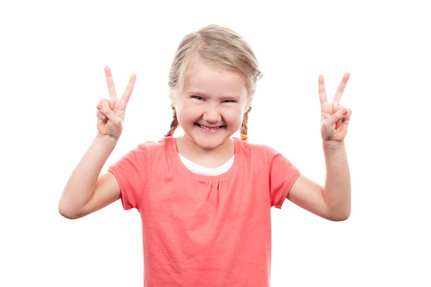 Cute girl showing victory sign on white space