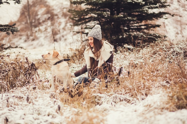 Cute girl sitting with dog