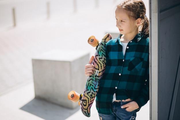 Cute girl skating in park