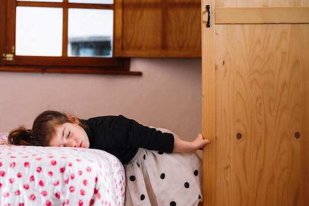Cute girl sleeping on bed