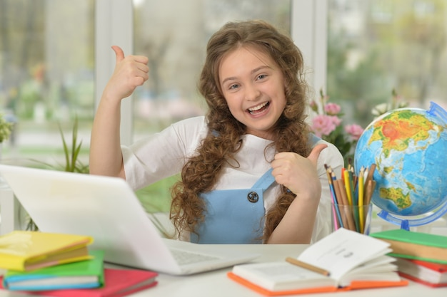 Cute  girl using laptop computer at home