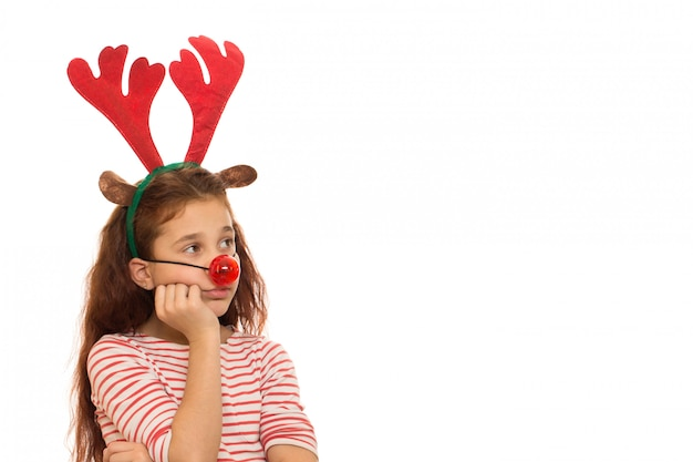 Cute girl wearing christmas antlers and red nose
