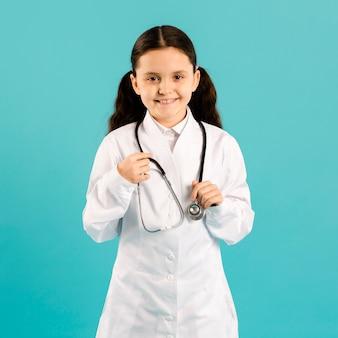 Cute girl wearing doctor uniform