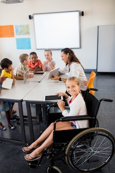 Cute girl in wheelchair posing for the camera