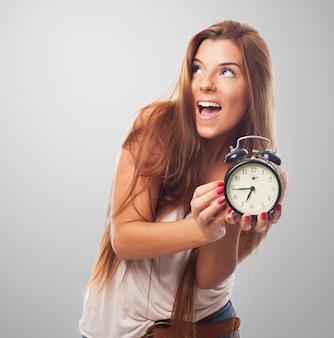 Cute girl with alarm clock