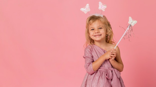 Cute girl with fairy costume and copy space