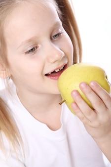 Cute girl with fresh apple