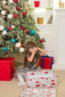 Cute girl with gifts on christmas time