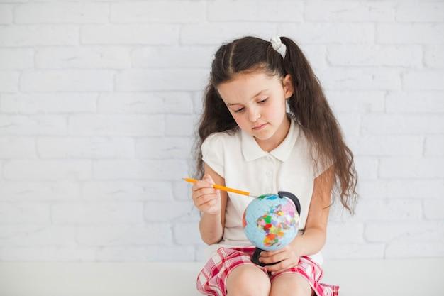 Cute girl with globe