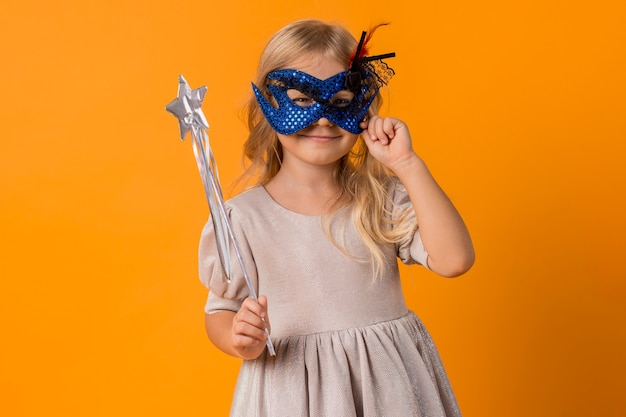 Cute girl with mask in costume
