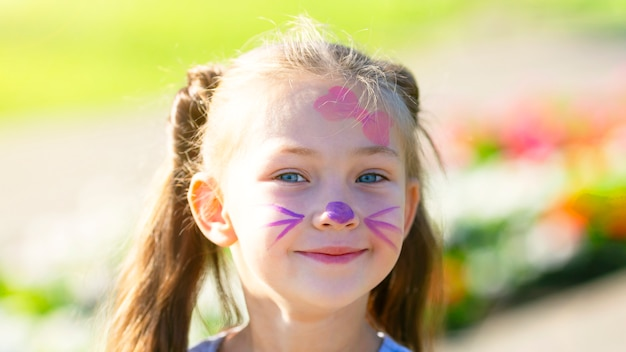 Cute girl with painted face.