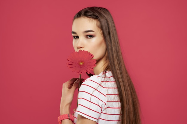 Cute girl with red flower striped tshirt cropped look luxury