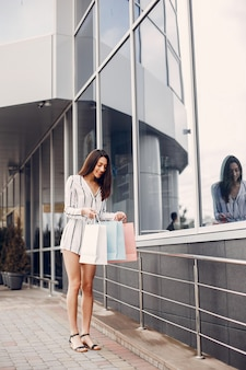 Cute girl with shopping bag in a city