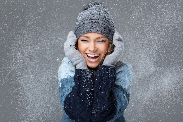 Cute girl with snowflakes having a good time