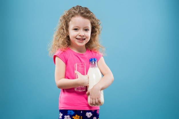 Cute girl with tumbler and milk container