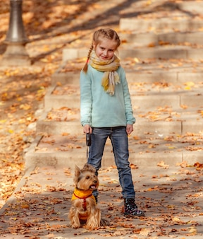 Cute girl with yorkshire terrier