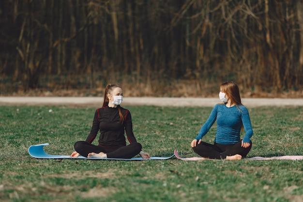 Cute girls doing yoga in a masks