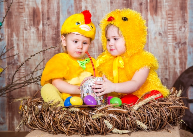 Cute girls play with real rabbit and duckling