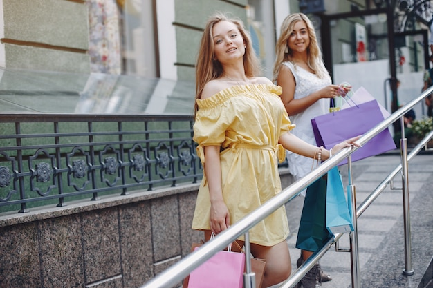 Cute girls with shopping bag in a city