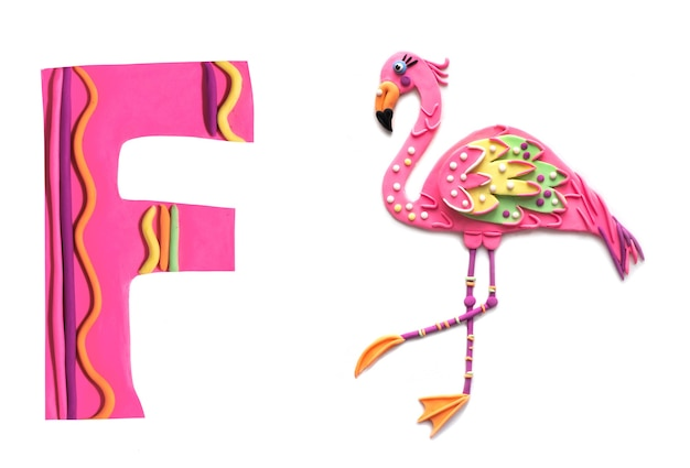 Cute handmade clay flamingo bird with a letter of english alphabet
