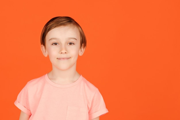 Cute handsome smiling preteen boy posing at studio. portrait of a cheerful young boy.