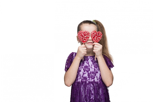 Cute happy little girl with lollipop caucasian on isolated white background