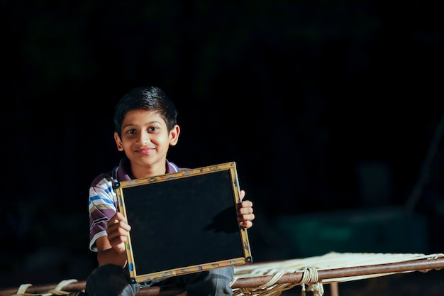 Cute indian child showing slate